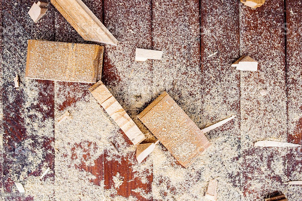 Close up of cutters of wood lying among sawdust stock photo