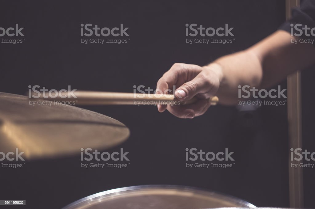 Close up of cymbal and man hand holding drumstick stock photo