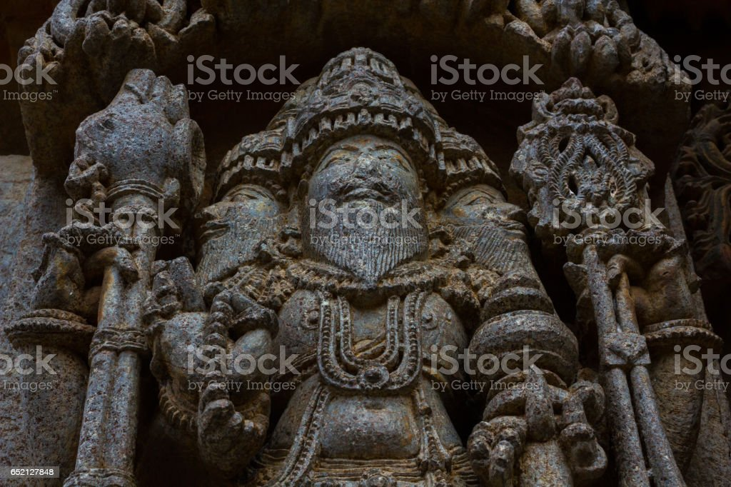 Close up of deity sculpture Brahma on shrine outer wall in the Chennakesava temple at Somanathapura,Karnataka, India, Asia stock photo