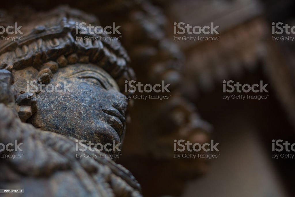 Close up of deity sculpture on shrine outer wall in the Chennakesava temple at Somanathapura,Karnataka, India, Asia stock photo