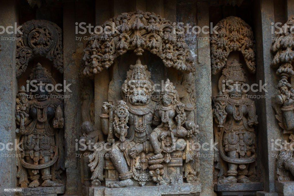 Close up of deity sculptureof Narasimha on shrine outer wall in the Chennakesava temple at Somanathapura,Karnataka, India, Asia stock photo