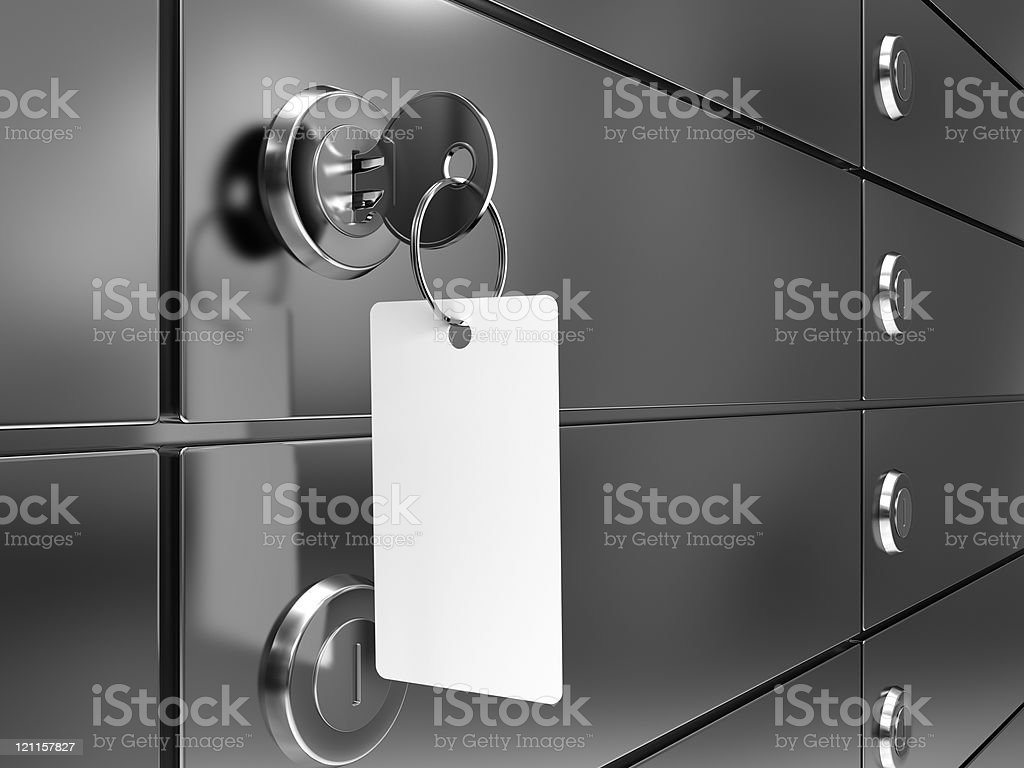 Close up of deposit box with key on white fob in lock stock photo