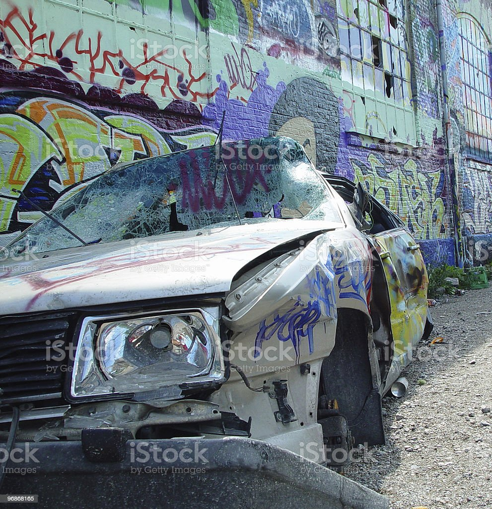 Close up of destroyed car and graffiti stock photo