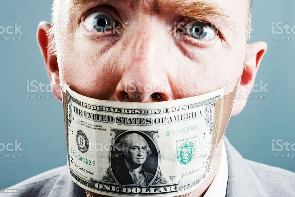 Close up of distressed frowning businessman in dollar gag stock photo