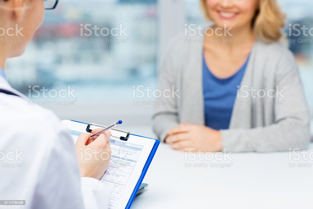 close up of doctor and woman meeting at hospital stock photo
