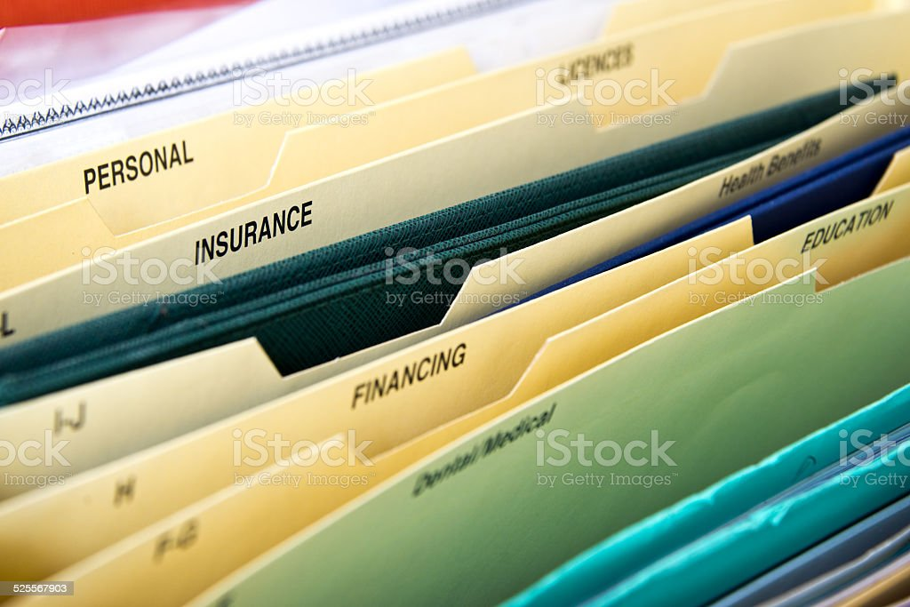 Close up of domestic personal files in expanding pocket folders stock photo