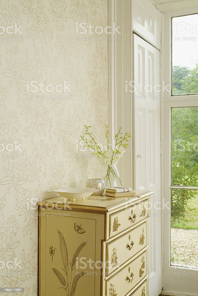 Close up of drawers next to window. royalty-free stock photo