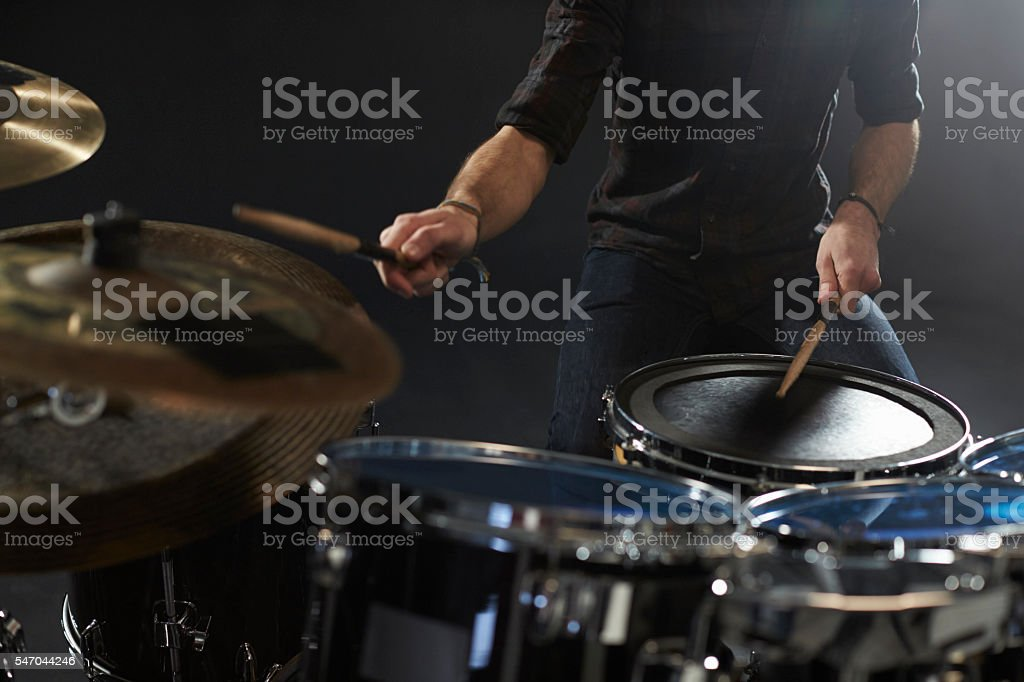 Close Up Of Drummer Playing Drum Kit In Studio stock photo