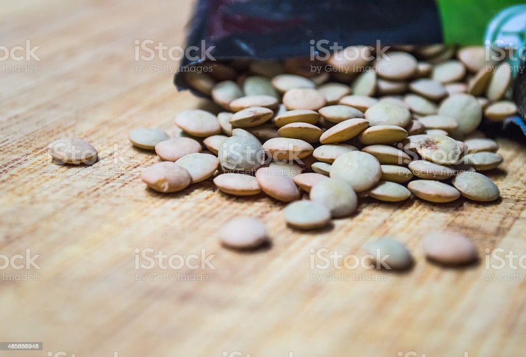 Close Up of Dry/Raw Brown and Green Lentils royalty-free stock photo