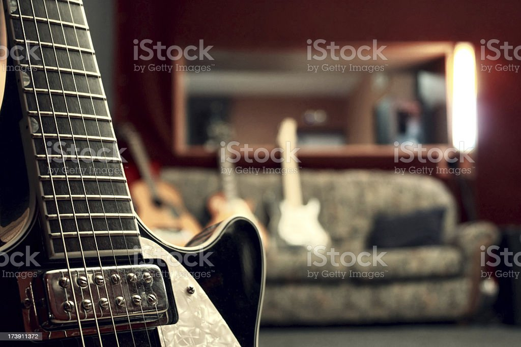 Close up of electric guitar in a studio royalty-free stock photo