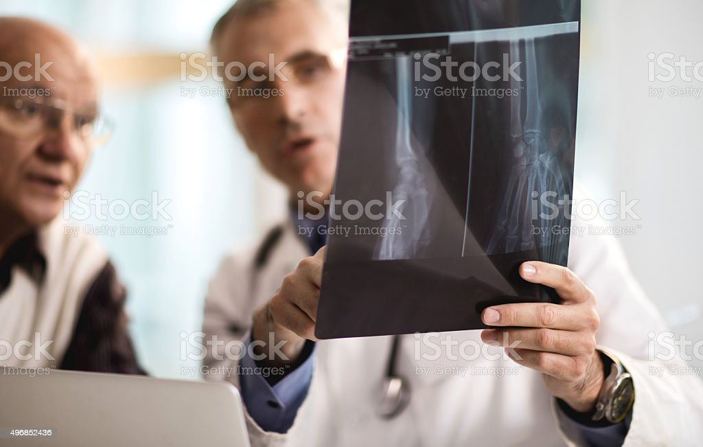 Close up of examining a medical scan at doctor's office. stock photo