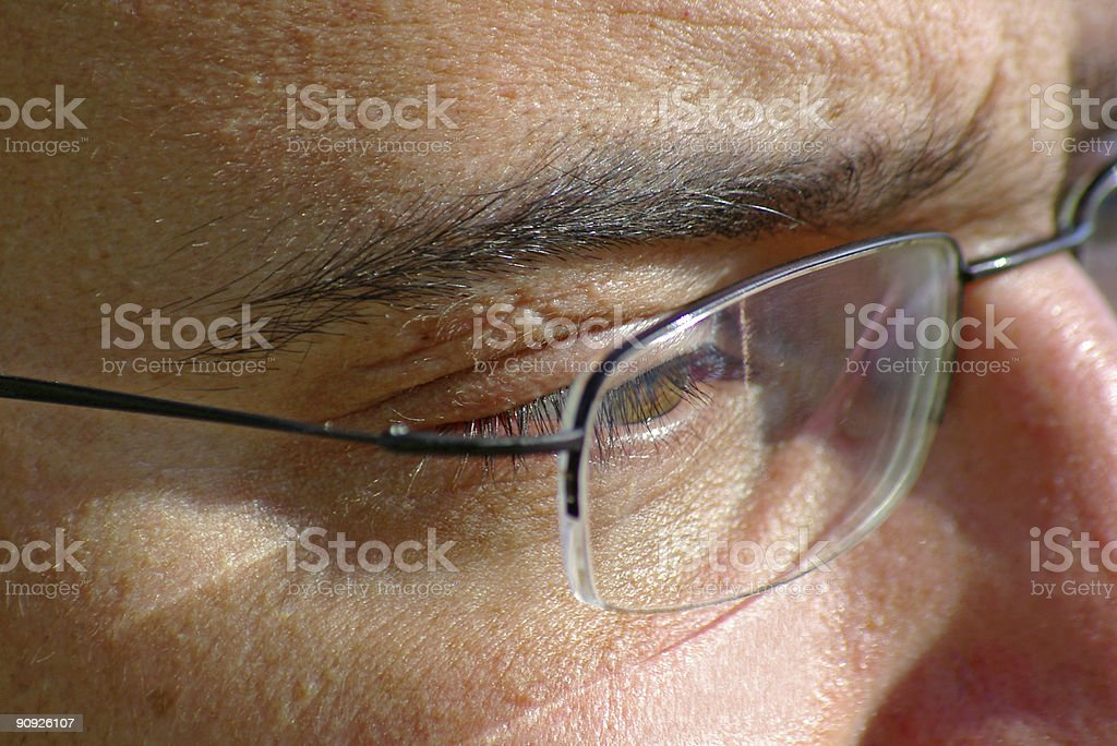 close up of eye and glasses royalty-free stock photo