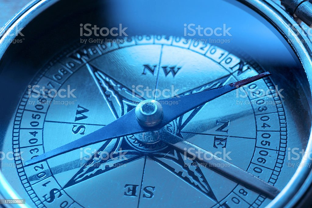 Close up of face of deep blue compass stock photo