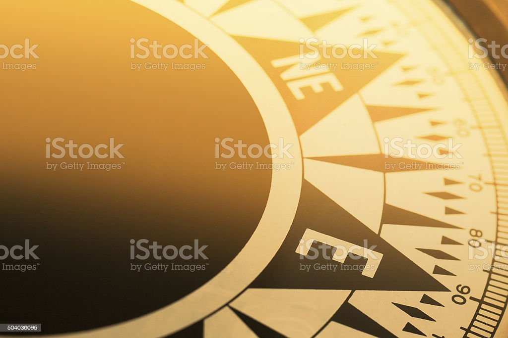 Close up of face of golden compass royalty-free stock photo