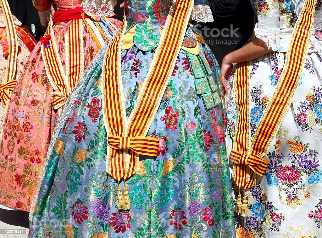 Close up of falleras costumes as they dance on the street stock photo