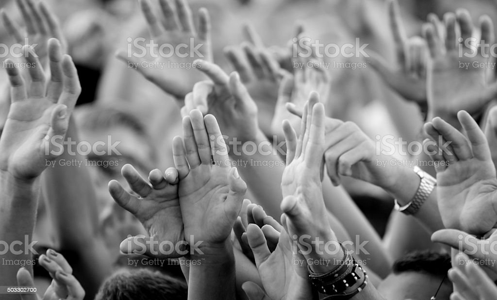 close up of fans hands at concert stock photo