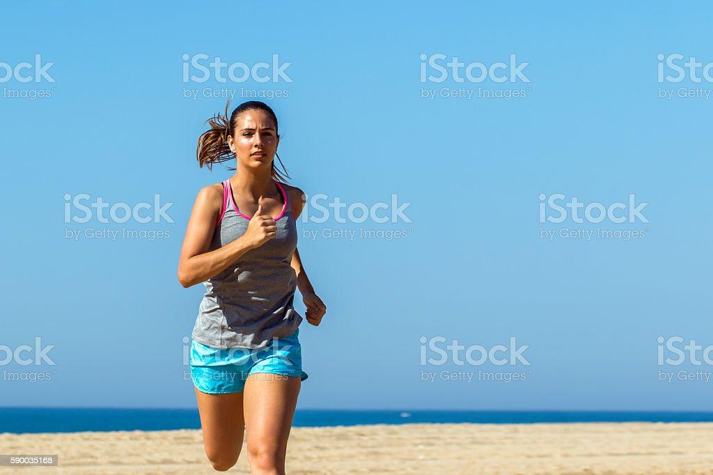 Close up of female athlete jogging. photo libre de droits