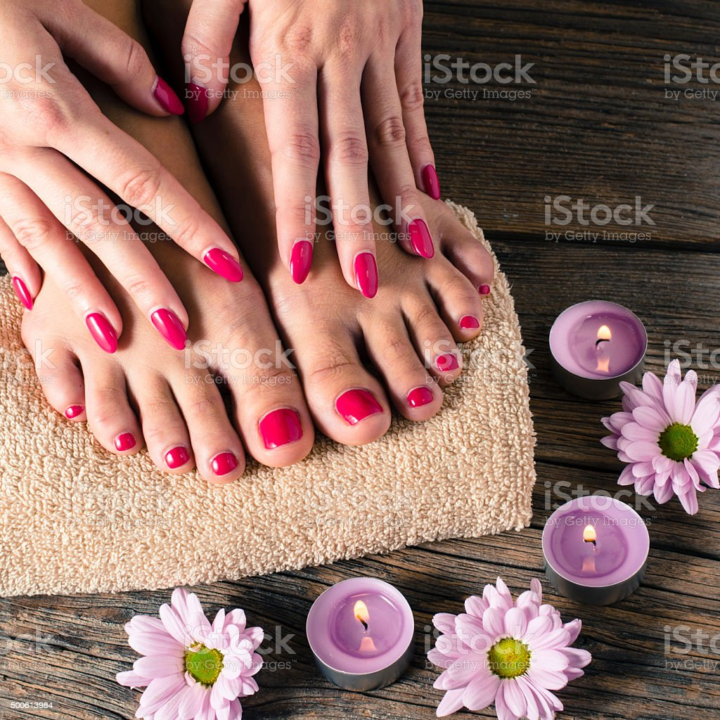 Close up of female feet and hands in spa salon stock photo