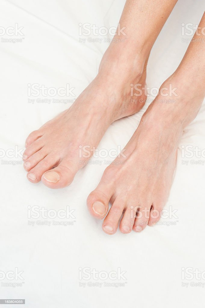 Close up of female feet on beauty treatment bed stock photo