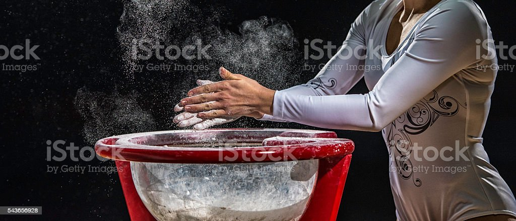 Close Up Of Female Gymnast Chalking His Hands stock photo