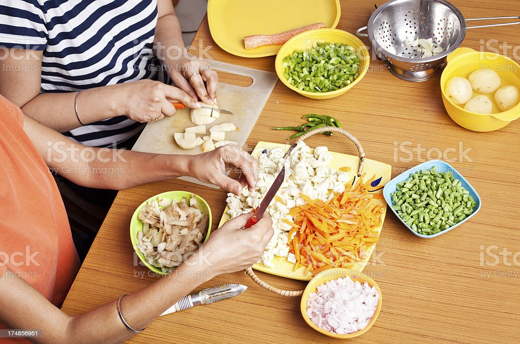 Close Up of female hands chopping cutting vegetables royalty-free stock photo