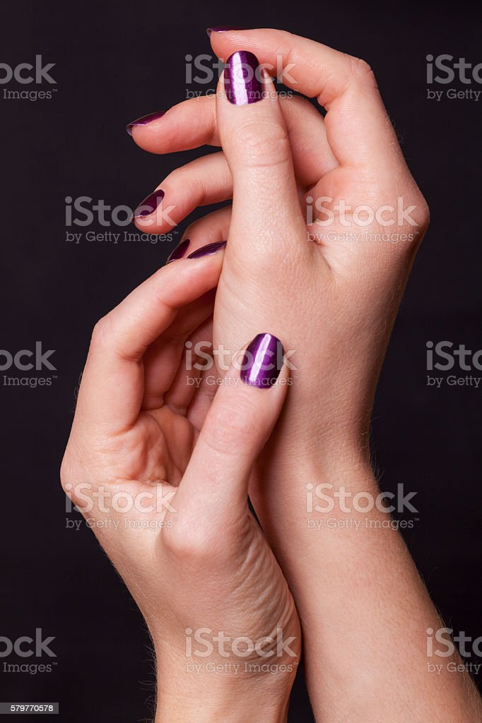 Close up of female hands over black stock photo