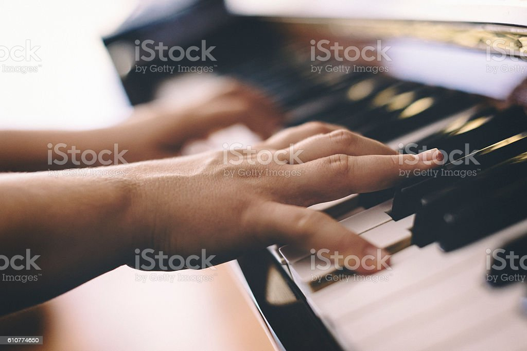 Close up of female hands playing piano stock photo