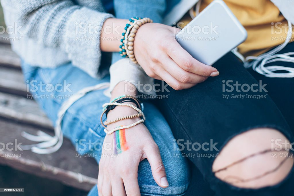 Close up of female hands with bracelets stock photo