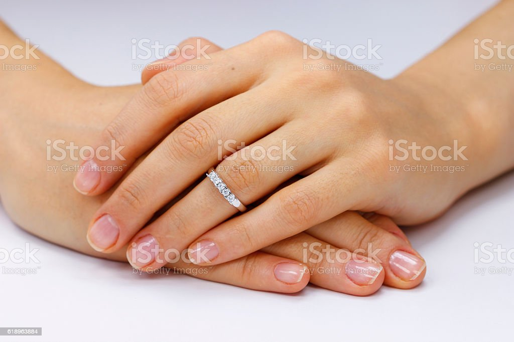 Close up of female hands with ring stock photo
