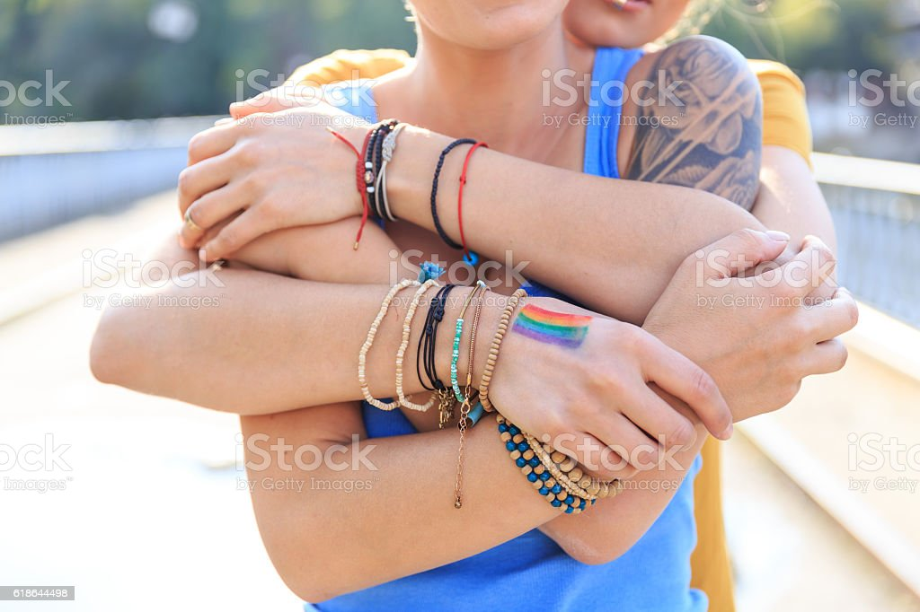 Close up of female intertwined hands stock photo
