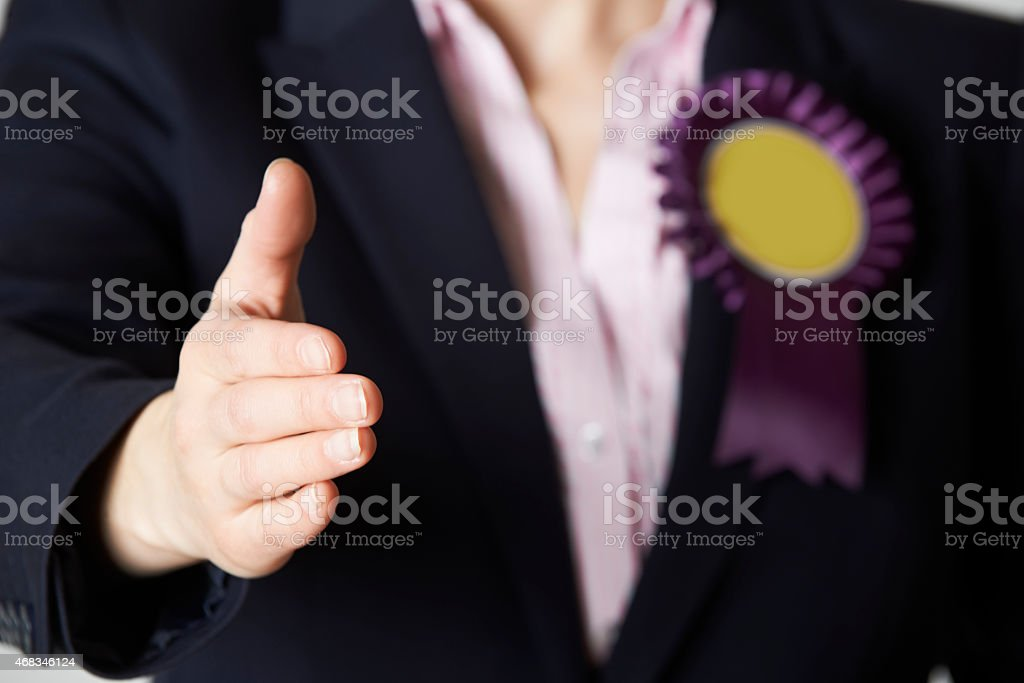 Close Up Of Female Politician Reaching Out To Shake Hands stock photo