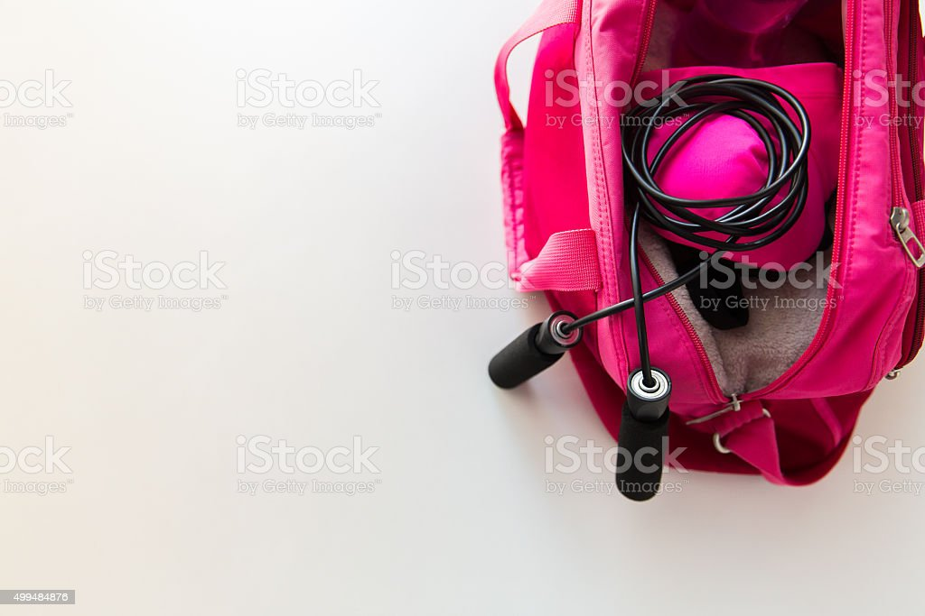 close up of female sports stuff in bag stock photo