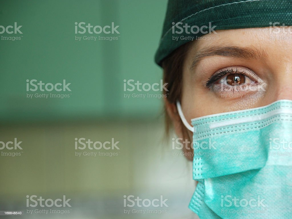 Close up of female surgeon wearing mask stock photo