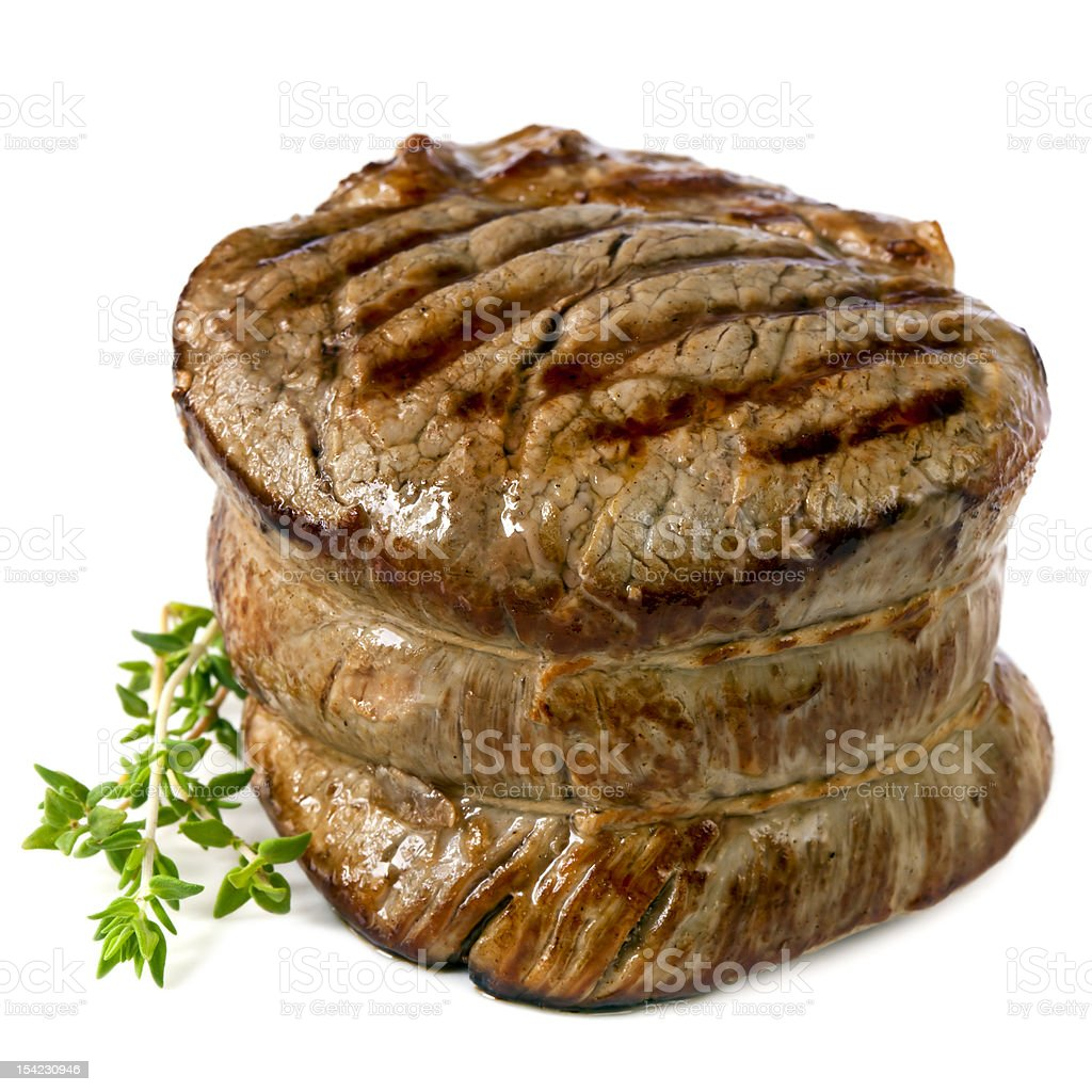 Close up of Filet Mignon isolated on white background stock photo