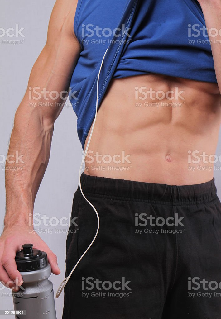 Close up of fit  muscular man torso after workout exercise. stock photo