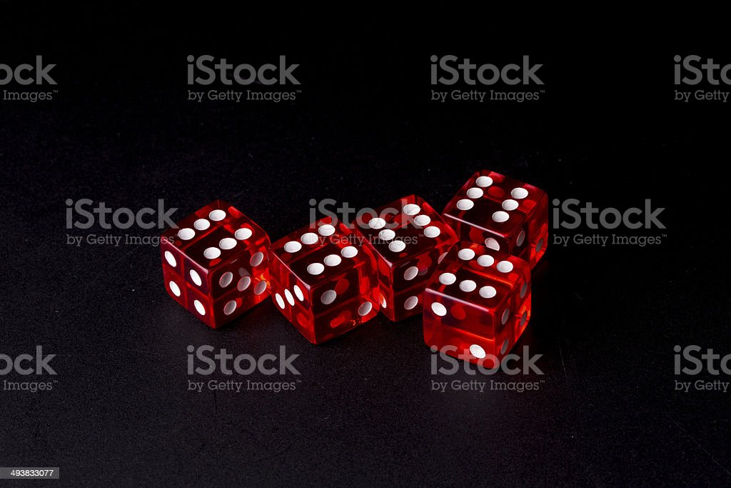 Close up of five red transparent dices on black stock photo