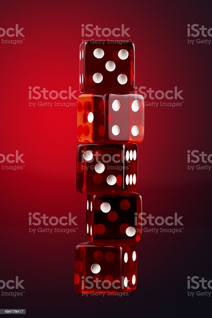 Close up of five red transparent dices on red-black stock photo