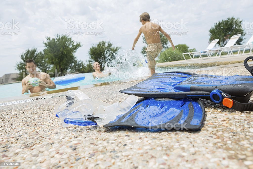 Close up of flippers near busy swimming pool royalty-free stock photo
