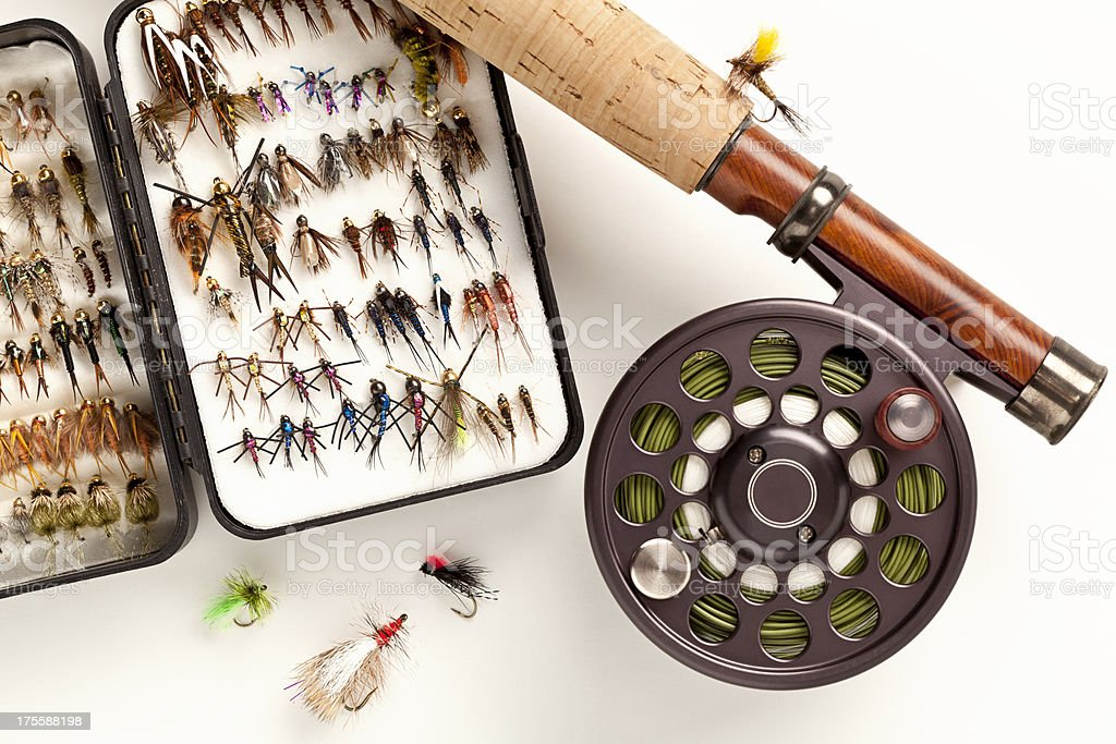 Close up of Fly-Fishing Rod and Lures on White. royalty-free stock photo