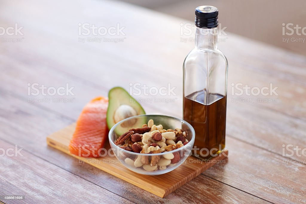 close up of food and olive oil bottle on table stock photo