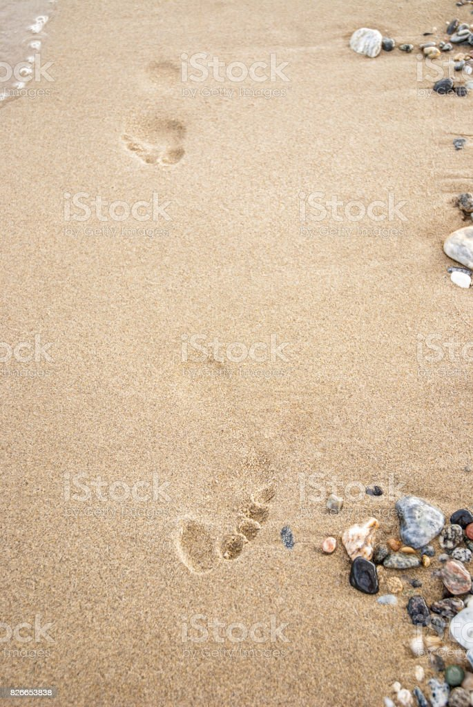 Close Up Of Footprints In The Sand stock photo