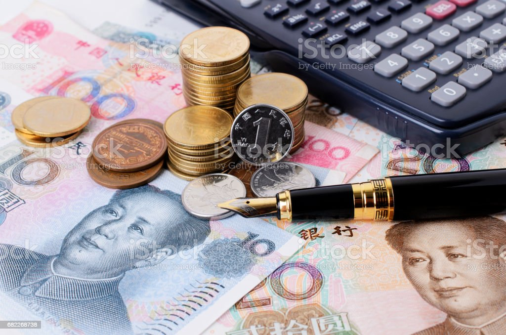 Close up of fountain pen and coins stack and calculator for financial concept stock photo