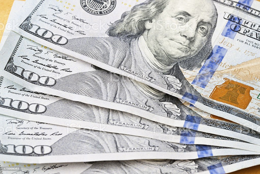 Close Up of Franklin on Hundred Dollar Bills Fanned Out royalty-free stock photo