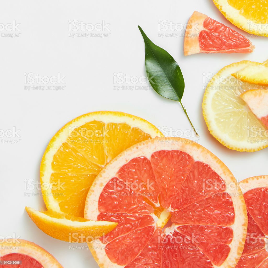Close up of fresh citrus slices and leaf stock photo