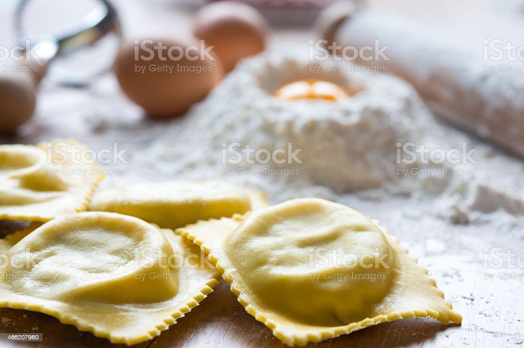 Close up of fresh handmade ravioli with flour and eggs stock photo