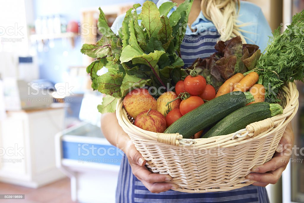 Close Up Of Fresh Produce In Basket At Farm Shop stock photo