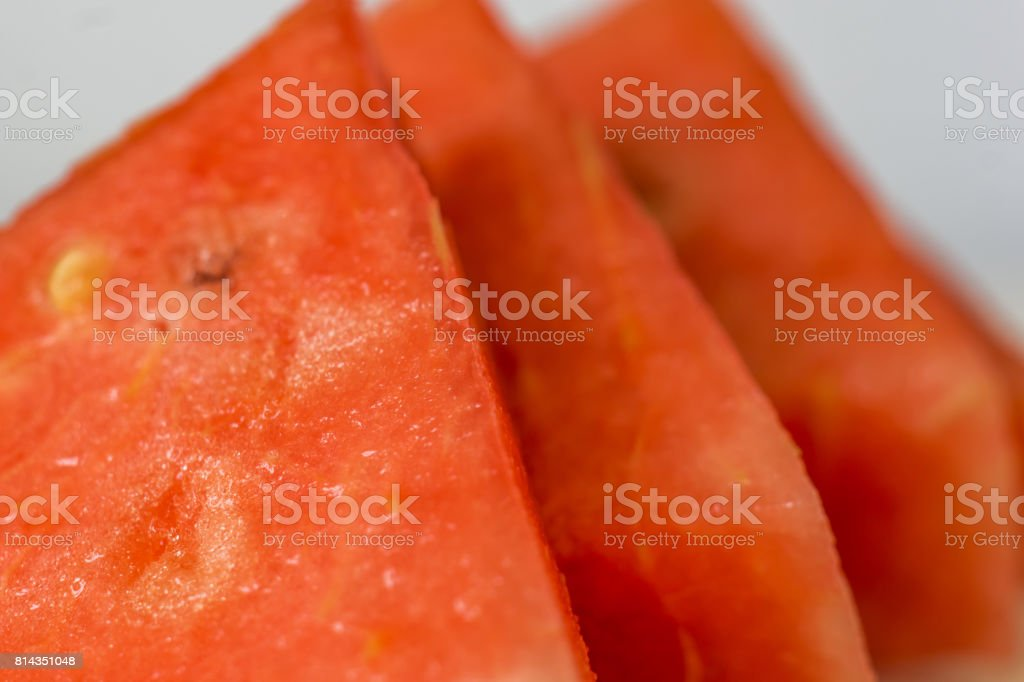 Close up of fresh, red watermelon, on a white background. Summer flavor. Shallow depth of focus. stock photo