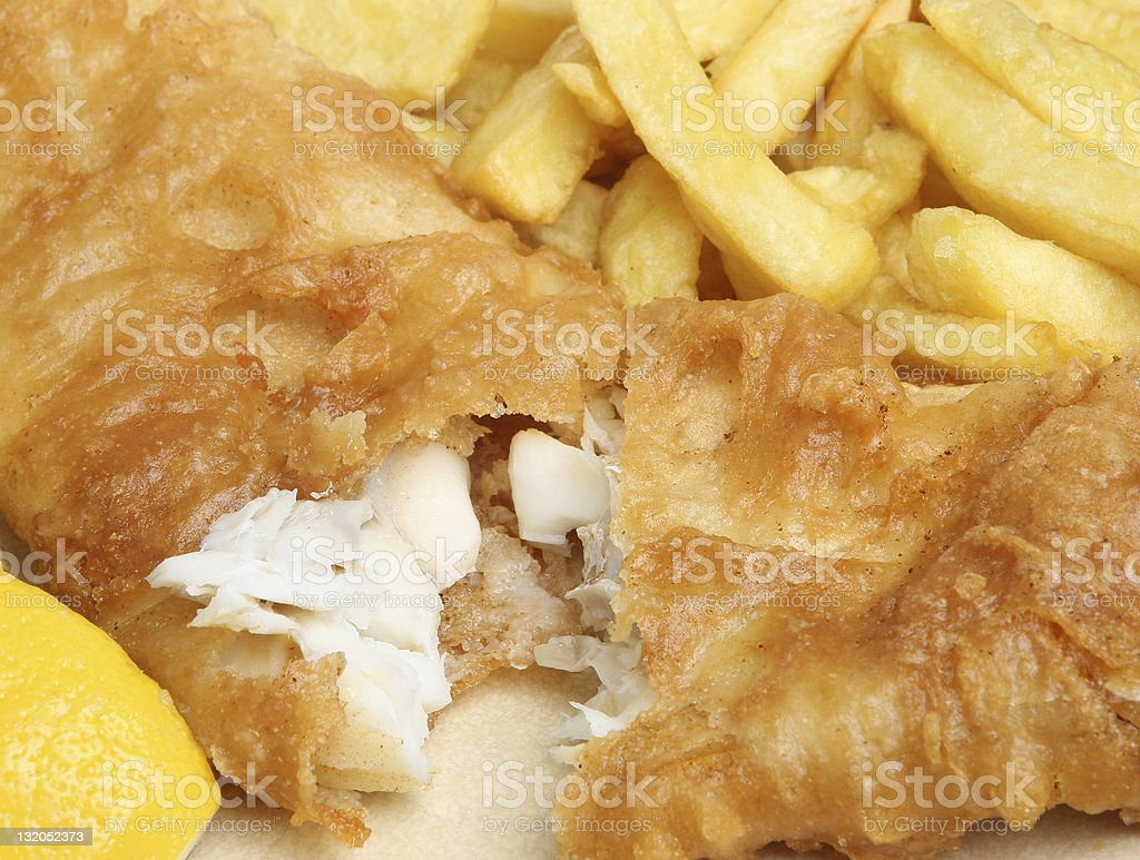 Close up of fried fish and French fries stock photo