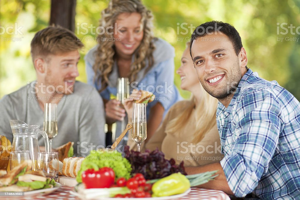 Close up of friends having picnic in park royalty-free stock photo