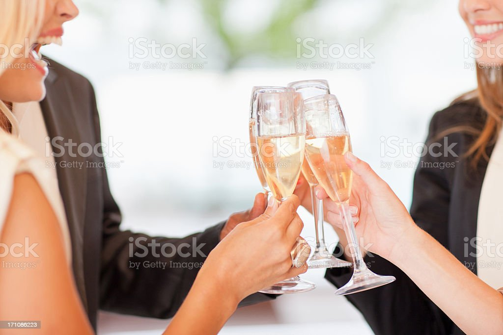 Close up of friends toasting champagne flutes royalty-free stock photo